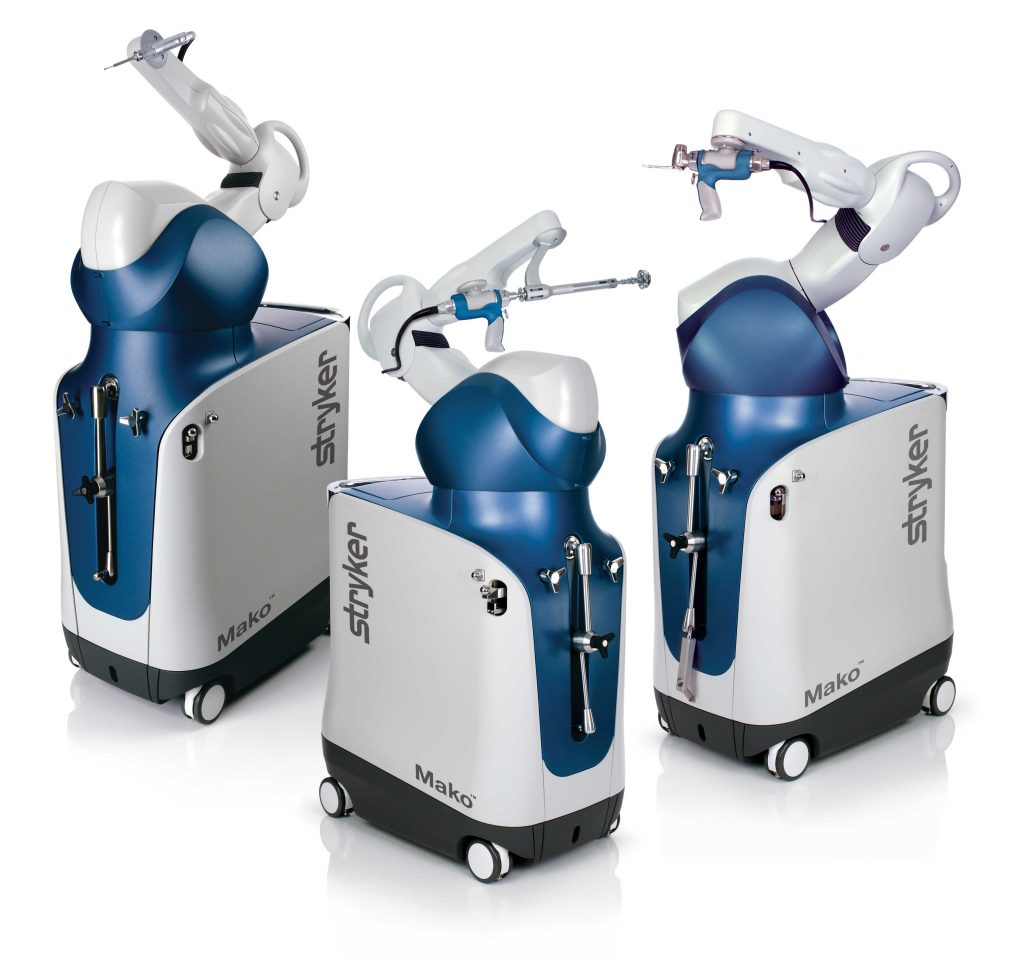 Three Mako System robots for robotic surgery.