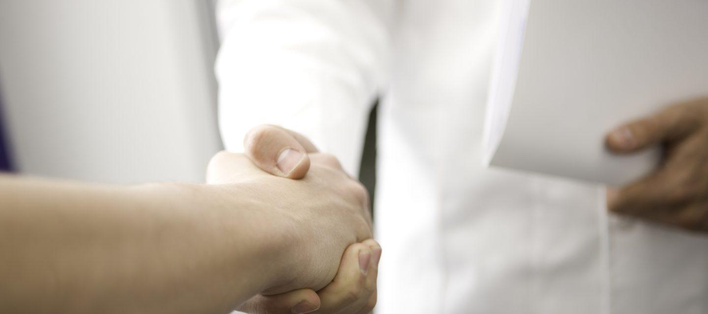 Doctor shaking patient's hand.